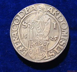 A silver Bohemian thaler (1525); an example of the coinage from which this post's title derives its terrible pun [Source]