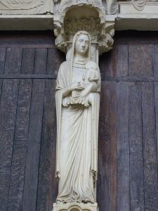 Sculpture of Anne holding the infant Mary; north porch of Chartres Cathedral. []Source